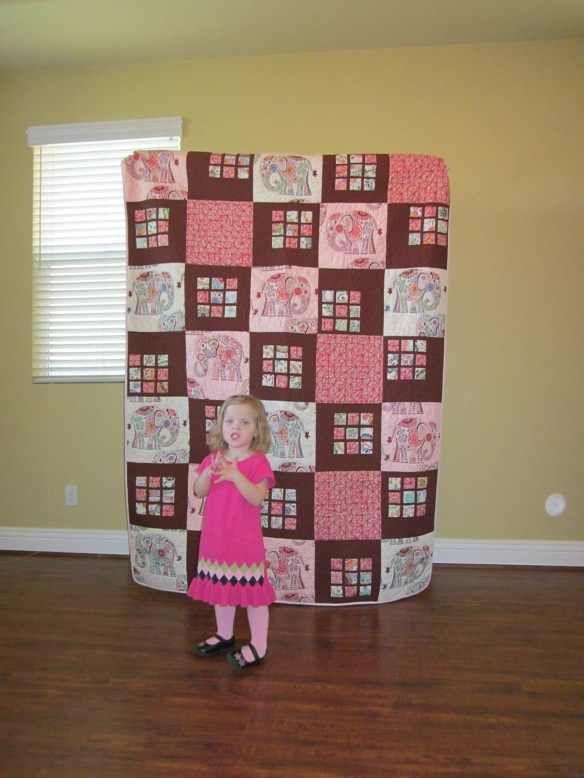 Quilt front with my niece. Photo by Kevin Driedger.